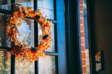 autumn wreath on the door of home