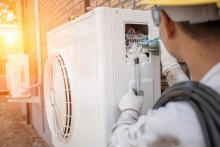 hvac tech installing heat pump