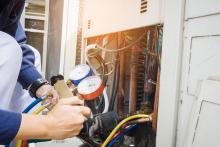 repair man fixing air conditioning