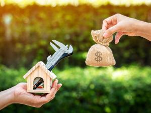 money bag and home wrench, rebates for home upgrades concept