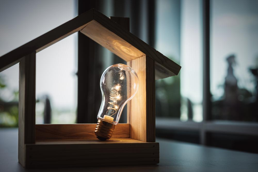 light bulb with model house, home electricity concept