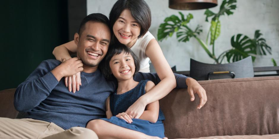 happy family of three in home